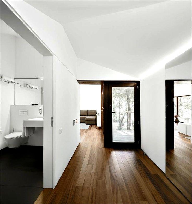Interior White Floors: White Wall, Wood Floor, Black Door Frame