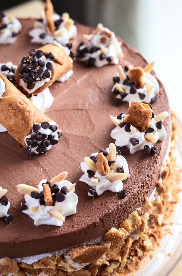 This fantastically decadent cake combines four very different desserts in to one - brownie, cheesecake, cannoli, and chocolate mousse!!