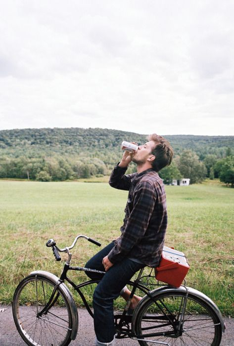 stylish, drinking, and riding a bike.  what not to like.