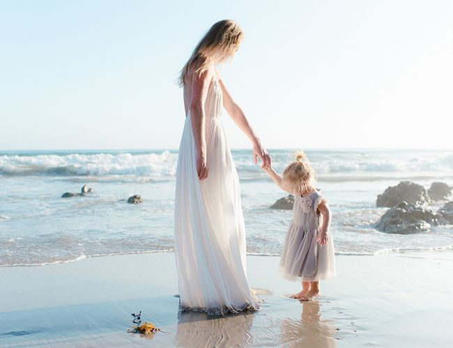 The stunning rocks, sunset timing, and a deserted stretch of beach created the perfect backdrop for this candid beach family session on our baby blog!