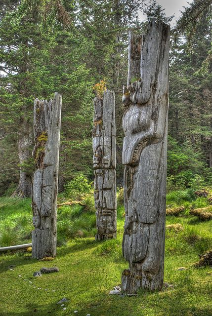 SGang Gwaay is located at the southern most part of Gwaii Haanas National Park in the Haida Gwaii Islands in British Columbia. It is a former Haida village and contains some of the oldest standing totem poles in the world. To get there you first have to get to Haida Gwaii, which while not that difficult, is pretty far out of the way for most people. Then you need to get on a boat which will probably take you 2 days of travel to get there.