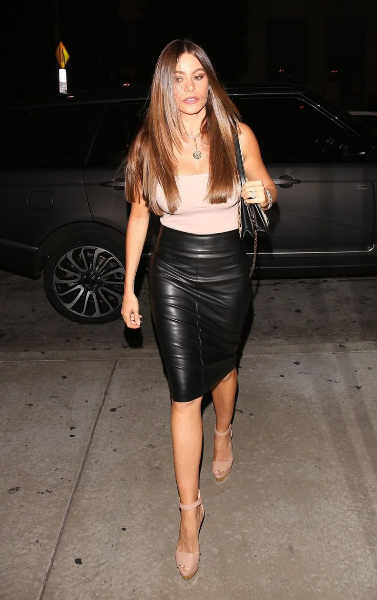 Colombian actress Sofia Vergara wearing a tight black leather pencil skirt: