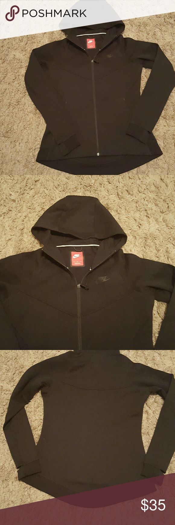 Nike Fleece Full Zip Hoodie Nike fleece hoodie new without tags,  never worn. Fits just past the waist in the rear. Includes Nike logo on front of jacket, pockets and thumb holes Nike Tops Sweatshirts & Hoodies