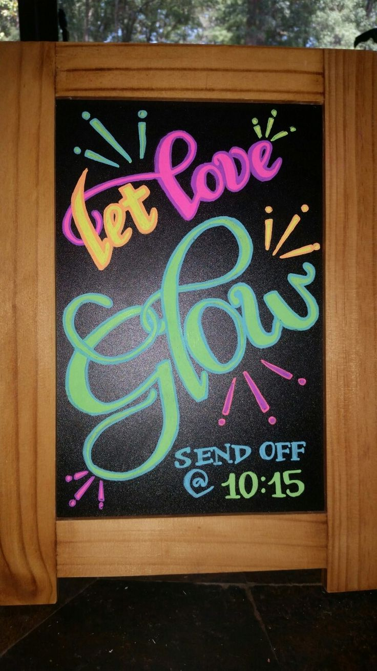 """Let Love Glow"" chalkboard sign for a glow stick or sparkler send off"
