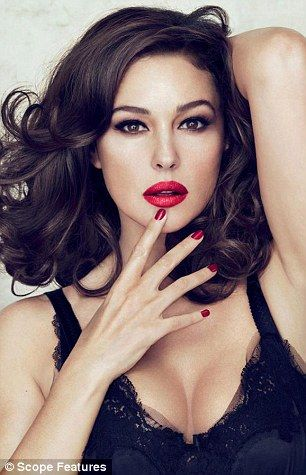 Loving life: Monica Bellucci, Spectre's Bond girl, in an advert for Dolce & Gabbana...