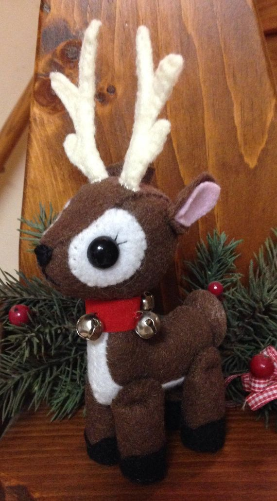 I am totally in love with this new creation! This completely hand sewn felt reindeer is approximately 5 inches tall (not including the antlers!) and approximately 4 inches wide. All pieces were hand c