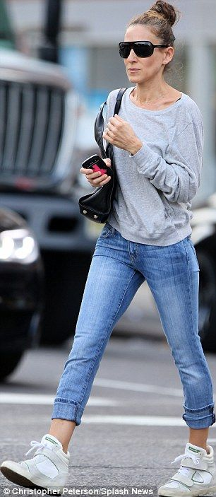 Casual customer: Just like her son, the actress donned a grey top, cuffed light blue jeans...