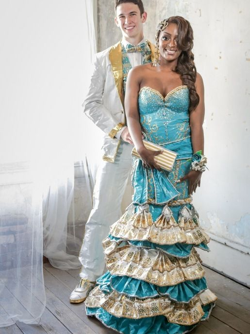 AMAZING Duck Tape prom dress!!  Vote daily until July 8 for Ronnita & Joseph #505. Go to http://www.duckbrand.com/promotions/stuck-at-prom/finalist_voting.