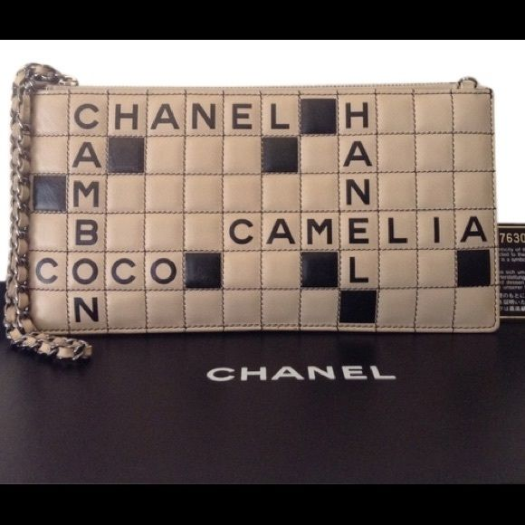 "Chanel RARE Ltd Ed Scrabble Bag. Collectors Item. Chanel RARE LTD Edition Scrabble Bag! Beautiful Collectors Items! This whimsical bag is quintessential CoCo Chanel. She was known to have quite a sense of humor & an amazing eye for style & fashion. This is certainly her creation & design. Measures 9.75"" x 5"". A beautiful flirty wristlet. Black monogram interior fabric. This vintage collector's item comes w/ original box, authenticity card, dust bag & care card. This is a rare & beautiful…"