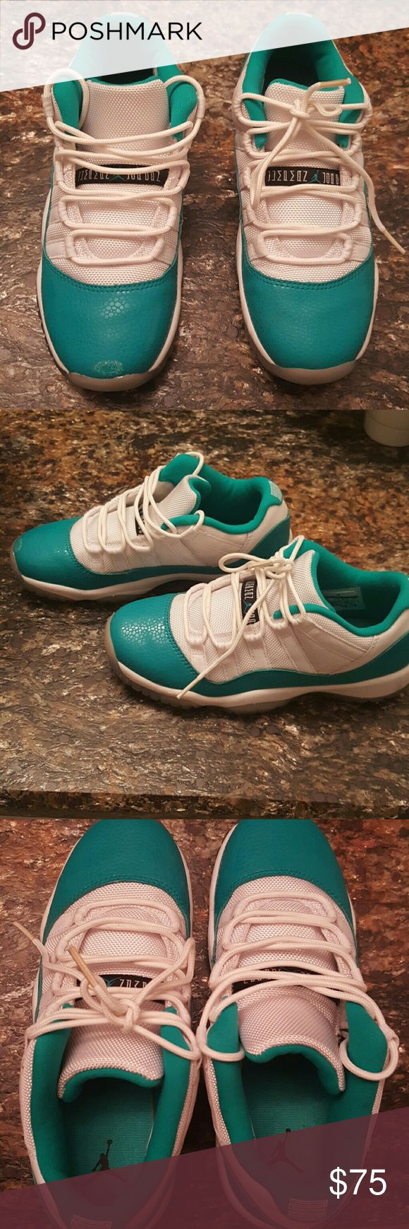 Youth Nike basketball shoes Authentic Nike Air Jordan 11 retro low sneaker. Rare sneaker. Excellent condition, please note small scuff to Right toe. White and teal in color. Nike Shoes Sneakers