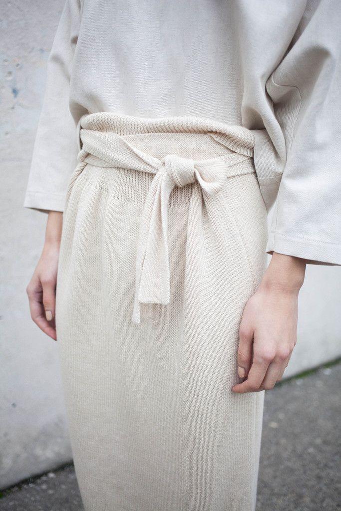 minimalist knit skirt with a trash bag waist