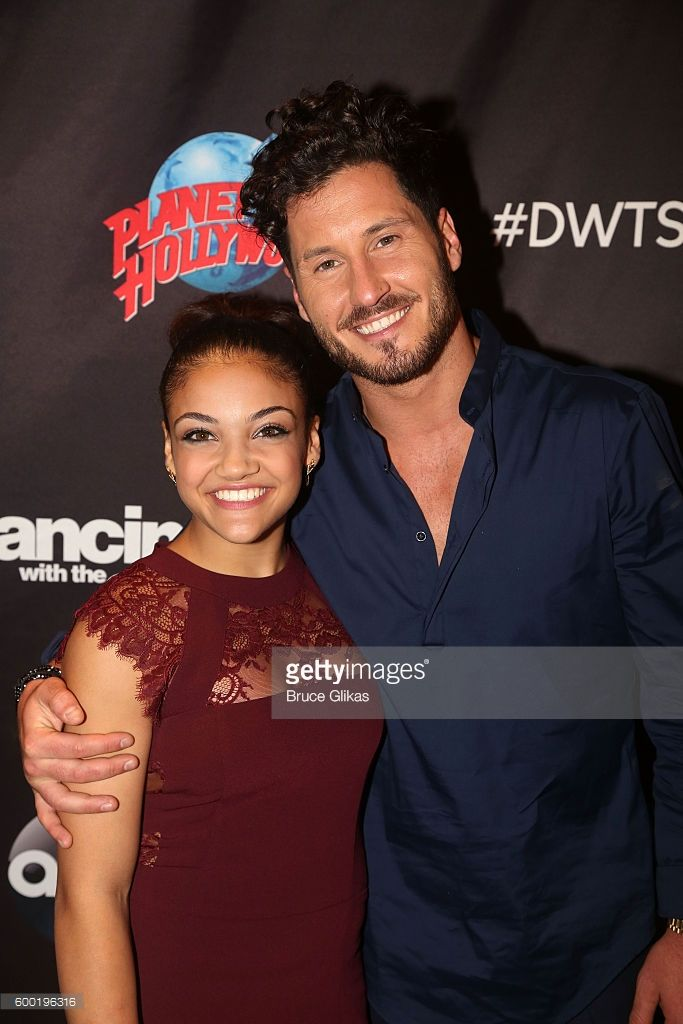 Laurie Hernandez and Valentin Chmerkovskiy pose as Season 23 of 'Dancing With The Stars' meets the press at Planet Hollywood Times Square on September 7, 2016 in New York City. .
