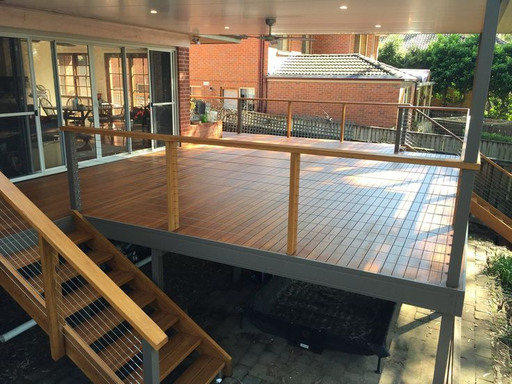 Stunning deck renovation by JGC Constructions in Quakers Hill. Nice use of screwless timber with stainless steel wire balustrade.