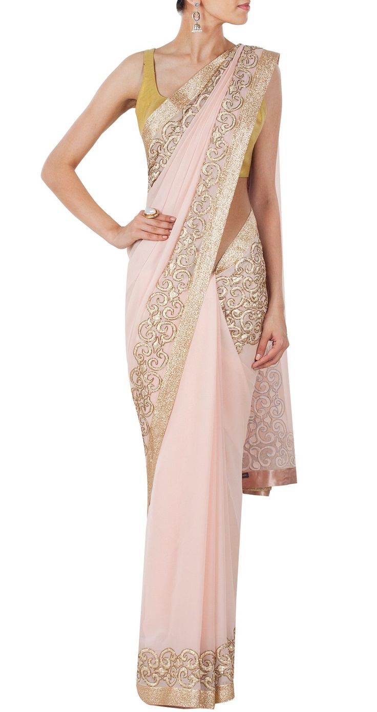 Priyal Prakash - Featuring an embroidered pink sari with gold applique work and aari work along the border. It comes with a light gold cotton brocade unstitched blouse piece.