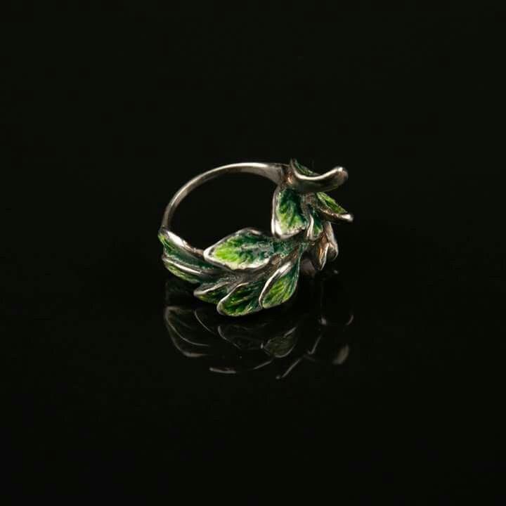 Silver leaf ring with green enamel.