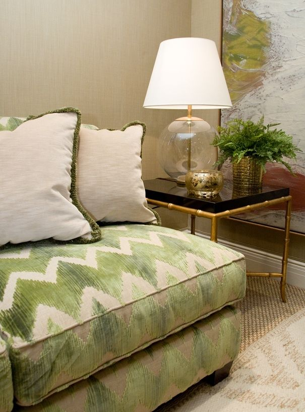 Sofa dressed in beautiful green and cream chevron AERIN for Lee Jofa fabric
