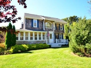 Porch East - Hampton Bays. This modern colonial house has all the comforts of a beach house including an open floor plan, skylights, farmhouse kitchen table...