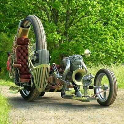 Steampunk motorcycle with a side cart.  Awesome!