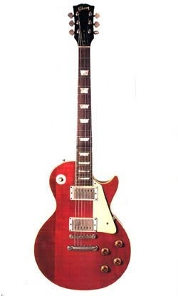 """George Harrison's cherry """"Lucy,"""" a 1957 Gibson Les Paul and a gift from Eric Clapton.: George Harrison, Cherries Red, Guitar Gentle, Paul 1957, Cherries Lucy, Gibson Les Paul, Harrison Cherries, 1957 Gibson, Eric Clapton"""
