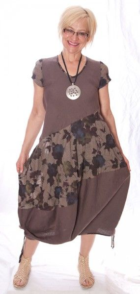 <p>Unique handmade linen bubble dresses, with slit pockets. Perfect for casual event. Made by artist designer using all European fabrics. One in Brown tones with flowers, size Medium (6/8US), One in Greenish tones in size Large (8/10US). Pre washed linen, wash in cold water by hand or delicate cycle, lay flat to dry. Only two left in stock!</p>