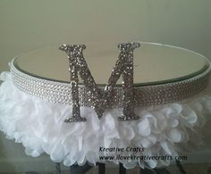 """Wedding Cakes Stand - White. Adorned with crystal and silk. Monogrammed """"M"""" with mirror top. Available in sizes up to 24"""" Kreative Crafts"""