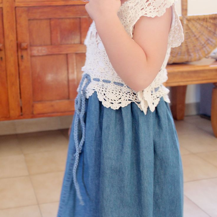 Gorgeous little girls soft blue denim dress featuring an up-cycled doiley. Classic old world pretty.