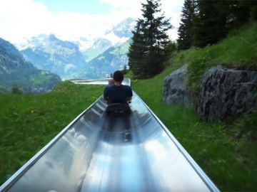 """SWITZERLAND: THIS SLIDE IS WHAT YOU ALWAYS DREAMED OF AS A KID -- In this video, watch """"the Mountain Coaster"""" in Kandersteg, Switzerland take you twisting and turning all around the Swiss Alps."""