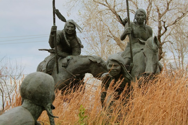 """Wee-Chi-Tah sculpture, Wichita Falls TX. A Comanche family crossing the Wichita river. The sculpture is by local artisan, Jack Stevens. Research tells us Caddo Indians called the Wichita people """"Wichitas,"""" which means Big Arbor -- due to the fact that the Wichita people lived along the rivers, often in houses thatched with leaves and limbs.  Image by roy luck, Flickr"""