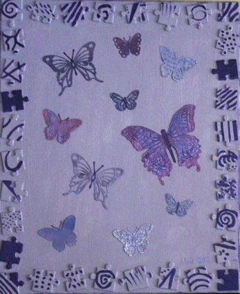 Butterflies painting. Diecuts, reused puzzle pieces, acrylic paints and mists. / Perhoset taulu.
