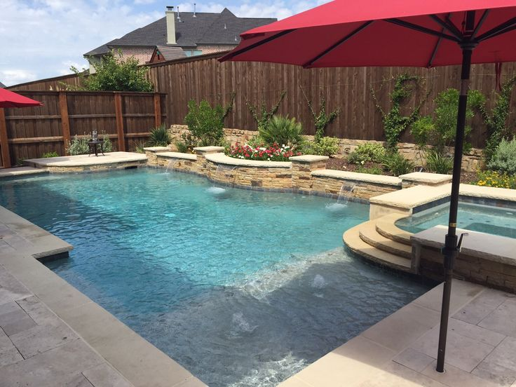 Dallas Formal Pools, Rockwall Custom Pool - formal-pool-spa-leuders-coping-travertine-pavers-pebble-plaster-aqua-blue-sheer-descents-raised-wall-with-mixed-veneer-