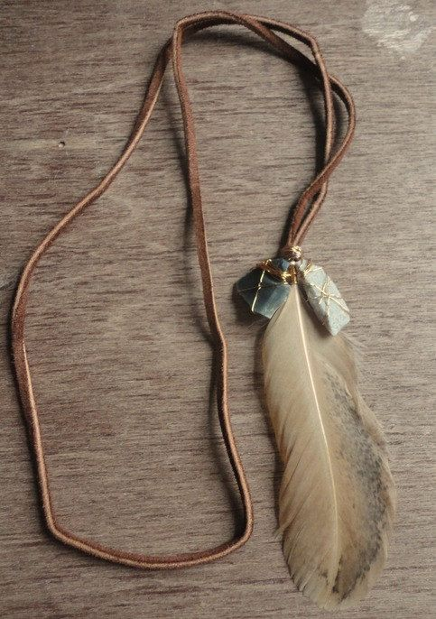 la belle vie. Leather cord+stones wrapped in copper wire+feather.
