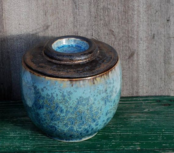 Ceramic urn for ashes, crystalline urn, stoneware pottery urn for human ashes, pet urn, keepsake urn, burial urn, funeral urn, pet urn.  5.5 tall 5.5 wide Maximum volume of the container about 1 cubic decimeter (61 cubic inches)  I created this special piece as a funeral urn. Ive
