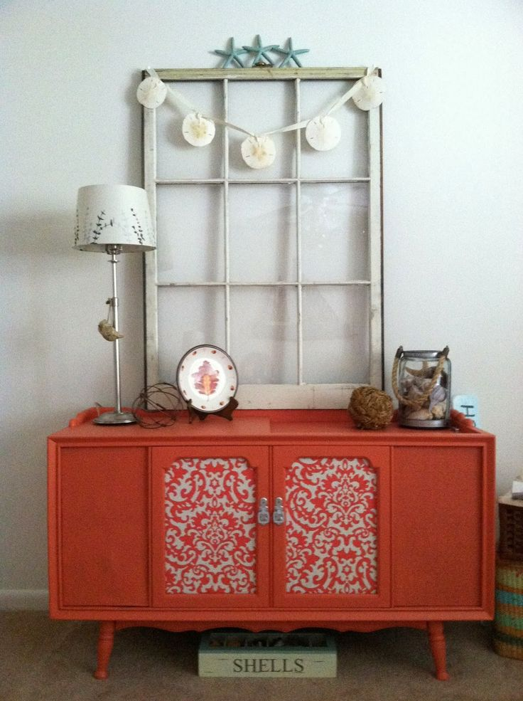 Coral Painted Stereo Cabinet Makeover. Great Beach Cottage Style!