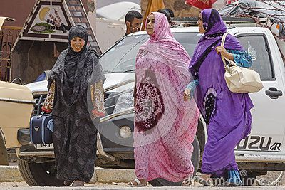 Muslim women on th side dirty and destroyed street  citie Taroudant in Morocco