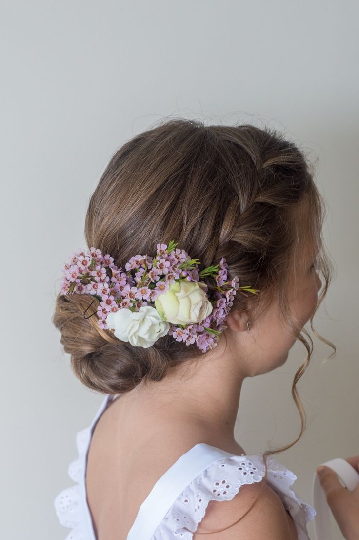 Barrels and a braided crown keeps your flower girls from feeling like the odd one out, with this young style