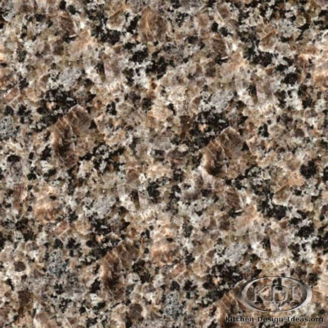 Caledonia Dark Granite - Kitchen Countertop Ideas.  Like the colors--goes with the white trim, wood floors and black appliances