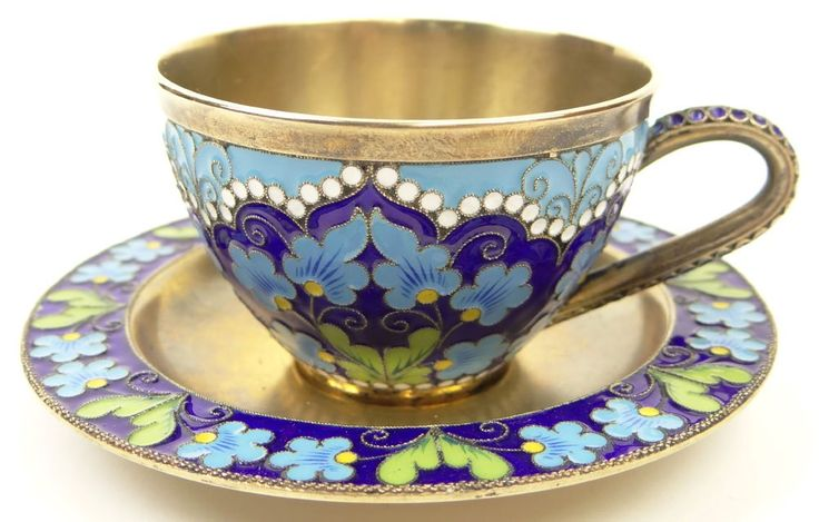 20th Century Russian Gilt Silver 916 Cloisonne Enamel Cup and Saucer. Decorated with Overall Blue, White and Green Floral Design. Marked with Russian Hammer and Sickle in Star and 916..