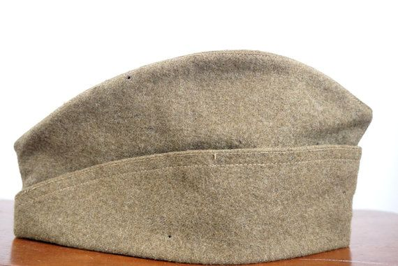 WW1 US Army vintage garrison cap,made from khaki green wool.This is a wedge style cap,and would be great for collectors.The hat is marked size 7 WAD 174 on the inside.  This cap measures 10 inches x 5 inches.  The condition is fair,with a few small moth holes and some general age/use wear.