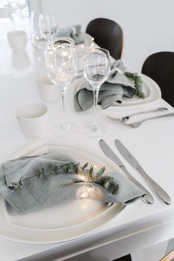 Table setting with linen and eucalyptus by Lisbet e.