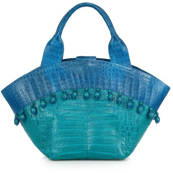 """Beaded trim gives this luxe bag a beachy feel.  Dual top handles, 7"""" drop.  Magnetic closure.  Attached beaded trim.  Protective crocodile feet.  Inside zip di…"""