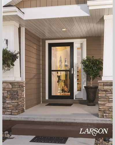 We love entries with beauty AND function. This black storm door has bevel glass for a touch of elegance, and the retractable screen increases fresh air flow for greater comfort and reduced cooling costs.   #WelcomeHome #MyLarsonDoor