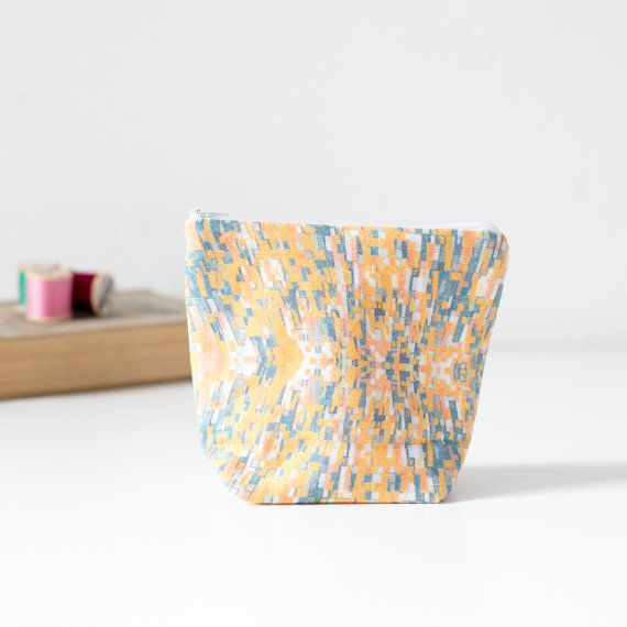 Orange and grey printed linen pouch with zip. by PixelAndThread