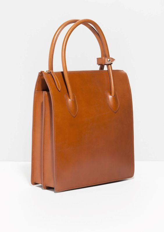 Crafted from sturdy and smooth leather, this polished-to-last tote will hold everything from knick-knacks and a sketchbook to beauty saviours, your favourite snacks and an extra scarf for chilly days.