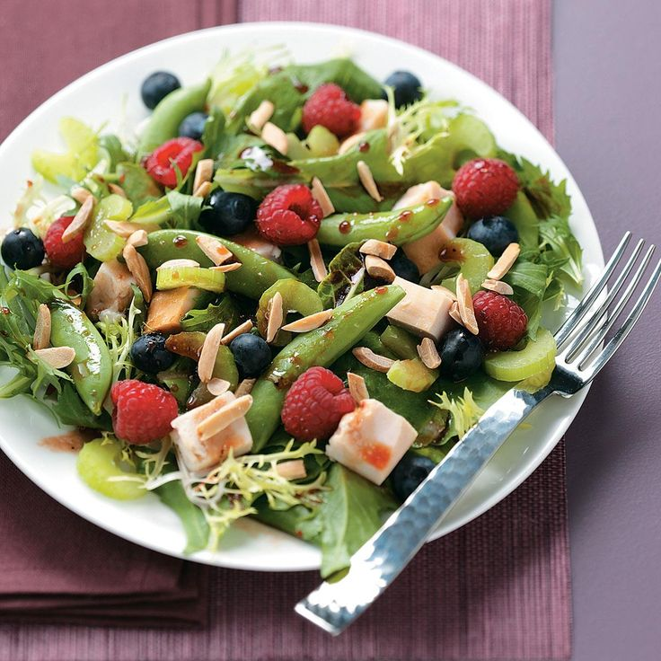 Summer Chicken Salad with Raspberry Vinaigrette Recipe -This best-of-the-season salad is guaranteed to be a hit! It's piled high with fresh fruits and veggies, chicken and greens, drizzled with a tasty raspberry vinaigrette—and simply delicious. —Heidi Farnworth, Riverton, Utah