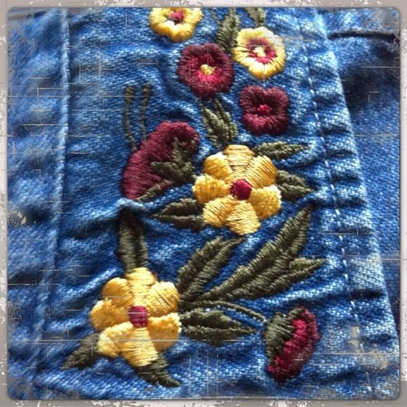Cute denim blouse Cute denim blouse with embroiled flower, distress look.Clean  Tops Blouses