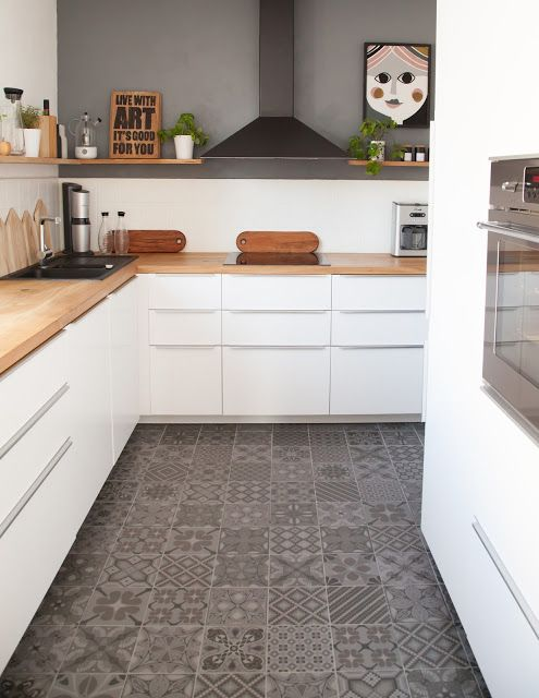 almost exactly our goal ... white cabs, wooden countertop and cementtile flooring <3