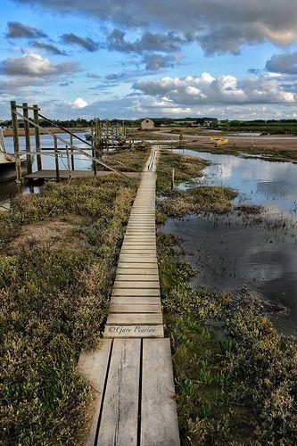 Old wooden walkway to the moorings at Thornham in Norfolk