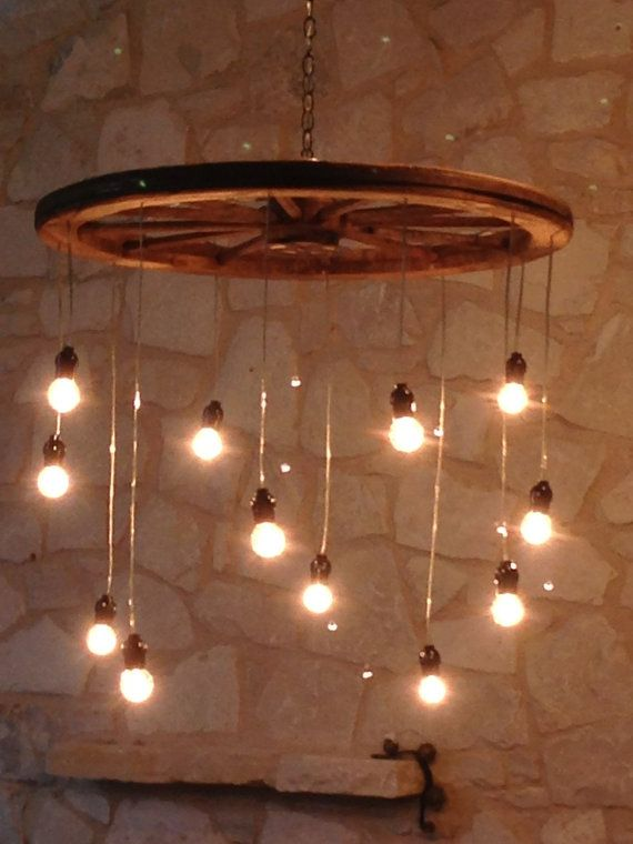 Idea for lighting to build: wagon wheel, pendant globe lights, chain. Random Length Wagon Wheel Chandelier large by RusticChandeliers, $400.00