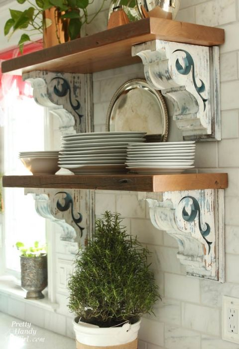 Salvaged Corbels - 10 Clever Ways to Repurpose Corbels - these shelves, against the subway tile backsplash, look awesome - via Tidbits and Twine