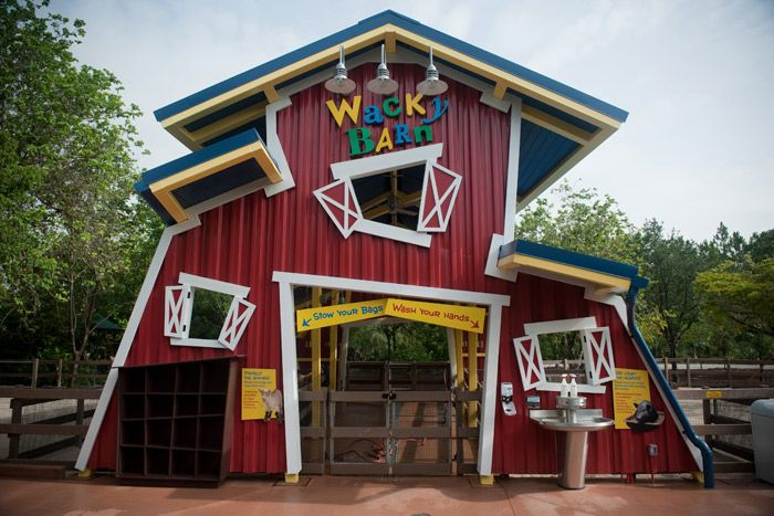 The colorful Wacky Barn has slanted architecture.
